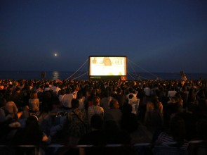 Free cinema on Barcelona beach in summer